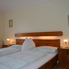 Double room with extra bed, shower, toilet, balcony