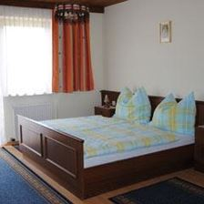double room with shower/toilet and 1 extra bed